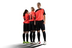Female soccer players in wall isolated on white stock photos