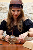 Female fortune teller looks to the viewer Stock Images