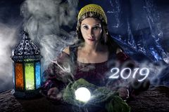 Fortune Teller Making Predictions for New Year 2019 royalty free stock image
