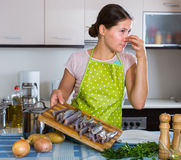Female with foul fish that stinks Stock Photos