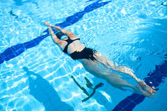 Female freediver diving in pool Royalty Free Stock Image