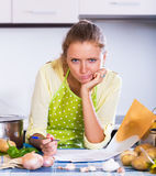 Female freelancer with documents at kitchen Stock Photos
