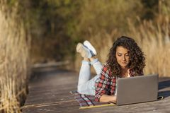 Female freelancer working in nature royalty free stock images