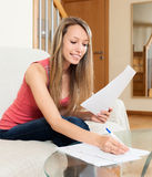Female freelancer working with documents Stock Photo