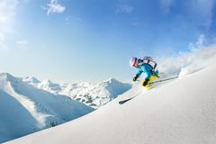 Female freeride skier in the mountains. Winter Stock Image
