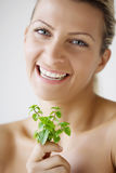 Female with fresh herbs Stock Image