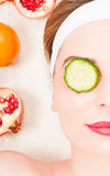 Female with fresh mask of fruits and vegetables. In closeup at dayspa Royalty Free Stock Images