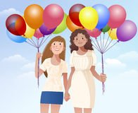 Female friend holding hands and balloons Stock Photography