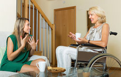 Female friend visiting disabled woman Royalty Free Stock Photography