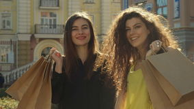 Female friends approve their shopping in the city stock video