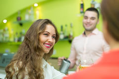 Female friends in the bar Stock Image