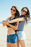 Female friends on the beach Royalty Free Stock Photography