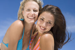 Female friends on beach together Royalty Free Stock Images