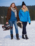 Female friends in beautiful winter day have relaxed walk on snow Stock Image