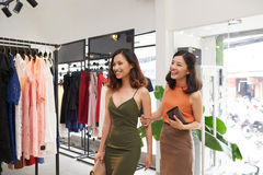 Female friends in boutique. Two beautiful Vietnamese ladies in clothing boutique Stock Photo