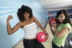 Female Friends At Bowling Alley Royalty Free Stock Images