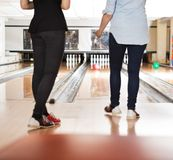 Female Friends Bowling in Club Stock Image