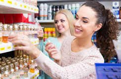 Female friends buying perfume Royalty Free Stock Image