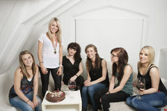 Female friends celebrating young woman's birthday Stock Image