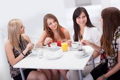 Female friends chatting over coffee Royalty Free Stock Images