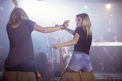 Female friends dancing at nightclub Stock Photography