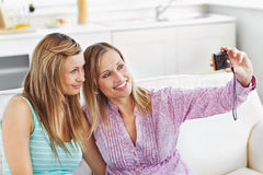 Female friends doing pictures of themselves Stock Images