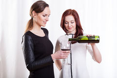 Female friends drinking red wine Royalty Free Stock Photography