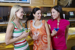 Female Friends With Drinks At Bar Stock Photo