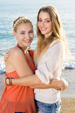 Female Friends Embracing Each Other at the Camera Royalty Free Stock Photo