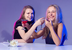 Female friends enjoying cocktails in a nightclub Royalty Free Stock Image