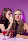 Female friends enjoying cocktails in a nightclub Royalty Free Stock Photo