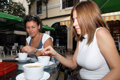 Female friends enjoying a cup of coffe stock images