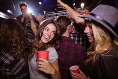 Female friends enjoying music festival Royalty Free Stock Images