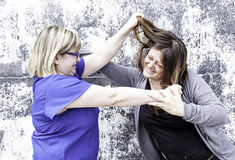 Female friends fighting Stock Images