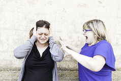 Female friends fighting Stock Image