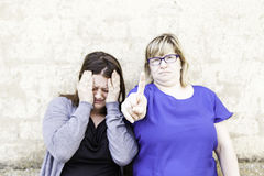 Female friends fighting Stock Photography