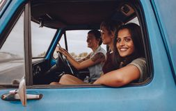 Female friends going on a fun road trip royalty free stock photo