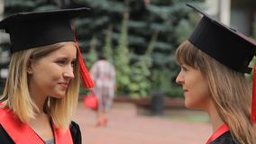 Female friends graduates discussing future holidays, friendly conversation stock video