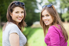 Female friends on a green glade Stock Photo