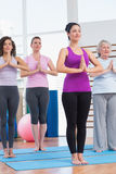 Female friends with hands clasped exercising in gym Royalty Free Stock Photo
