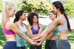 Female friends with hands stacked together Stock Images