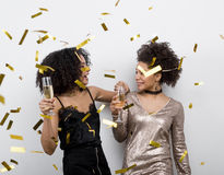 Female friends have fun with confetti royalty free stock images
