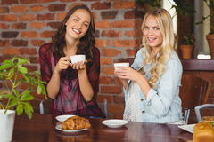 Female friends having coffee at coffee shop Stock Photo