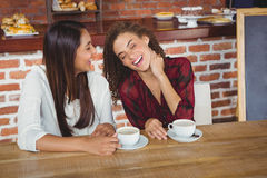 Female friends having coffee Royalty Free Stock Images