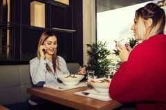 Female Friends Having Lunch Stock Photography