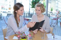 Female friends having lunch together royalty free stock image