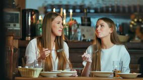 Female friends having lunch together at the cafe.  stock footage