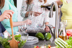 Female friends having a party in the kitchen Royalty Free Stock Photography