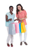 Female friends holding shopping bags Royalty Free Stock Photos