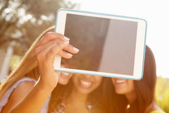 Female Friends On Holiday Taking Selfie With Digital Tablet Royalty Free Stock Photography
